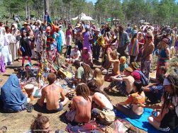 crowd-around-altar-rainbow-gathering-hippie